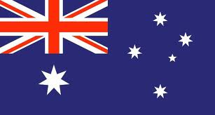 Australian flag, dark blue background, white stars and a red union jack