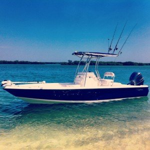 beautiful blue Edgewater boat in shallow water