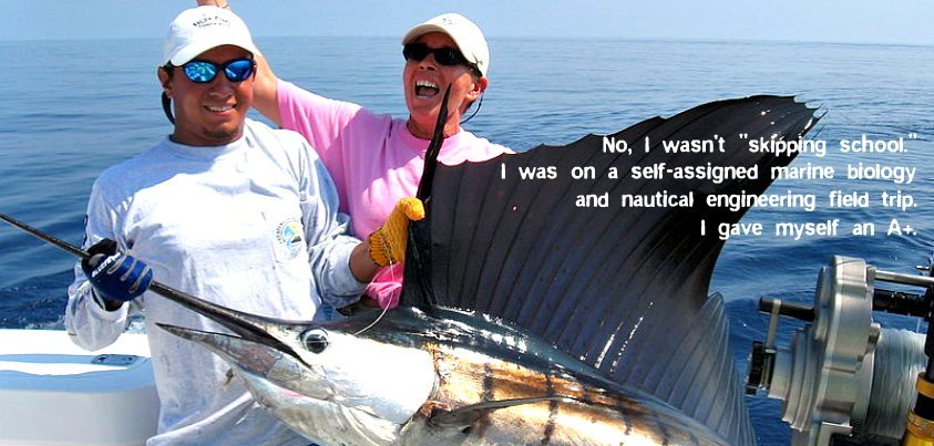 two people in a boat holding a large sailfish
