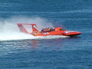 Speedboat flying down the water
