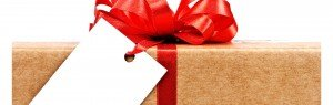 present wrapped in brown paper tied with a big red bow