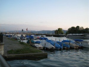 photo of a marina with many boats with covers