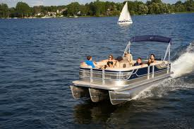 family enjoying a pontoon ride on a sunny day