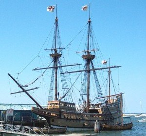 a replica of the Mayflower at a dock