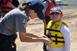 child being fitted for a life jacket