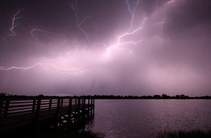bright lightning over a lake and dock