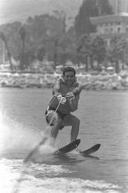 black and white image of a man waterskiing