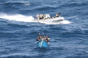 U.S. coast guard in an inflatable boat arresting a boat of pirates