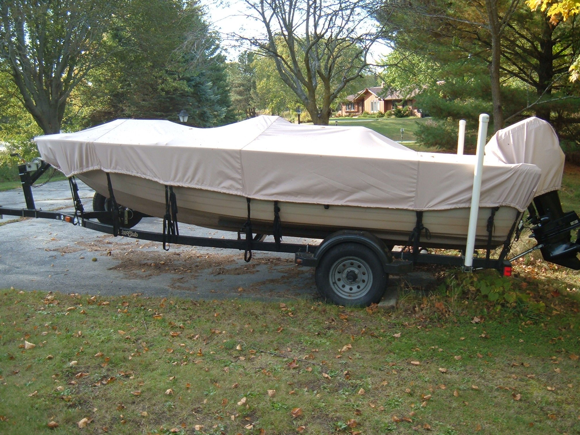Beige Boat Cover Tied Down