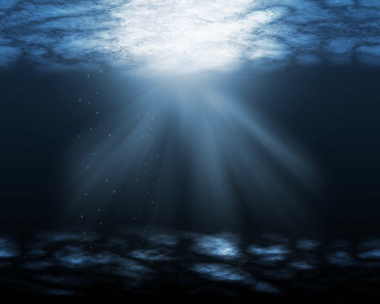 under dark ocean with light shining through