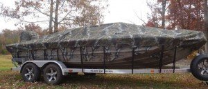 camo boat covered with a camo cover
