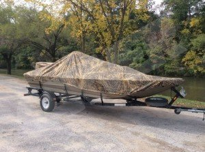 boat with camo boat cover