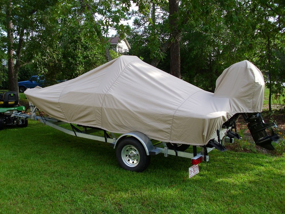 Rear View of a trailered Carolina Skiff JV 17 CC with a beige Carver Performance Poly-Guard boat cover