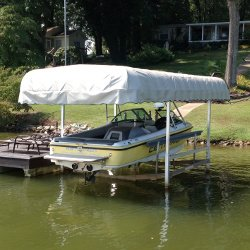 ShoreMaster boat lift canopy with white Shelte-Ritesup®/sup vinyl cover over a Centurion - Lake Bowen - South Carolina