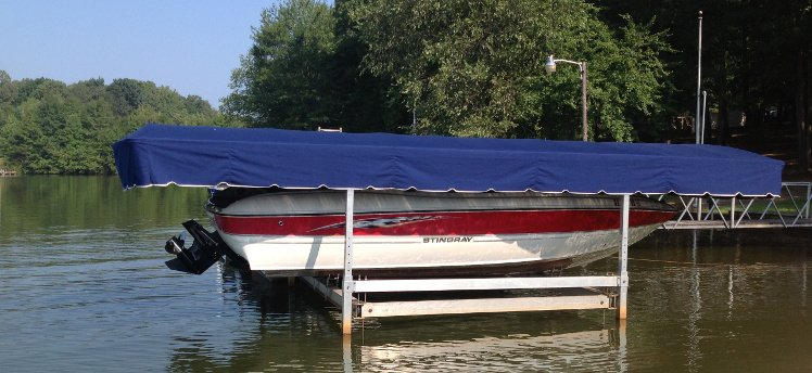 Stingray boat with a blue lift canopy - Lake Bowen, SC