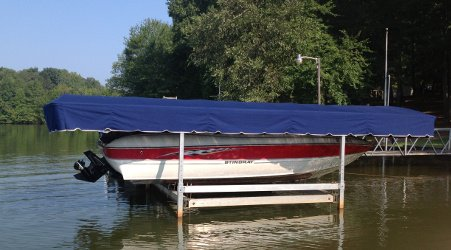 Adrimal Blue WeatherMaxsup®/sup ShoreStationsup®/sup boat lift canopy cover above a Stingray - Lake Bowen - South Carolina