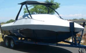 Tournament Ski Tower Boat on a Trailer with a Carver Boat Cover